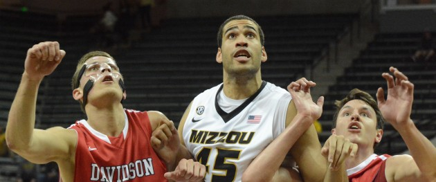 Missouri center Keanau Post battles for position on a rebound between Davidson defenders Chris Czerapowics (left) and Tyler Kalinoski (right) on Tuesday, March 18, at Mizzou Arena. Tuesday was Post's fourth career start for the Tigers.