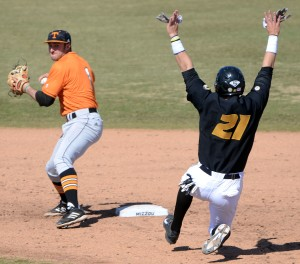 Tennessee second baseman Will Maddox prepares to throw to first base to complete the double play as Missouri junior Jake Ivory slides into second base during the sixth inning Saturday, March 15, 2014, during Game 1 of the doubleheader at Taylor Stadium. This is the second of three double plays Tennessee turned in the game.
