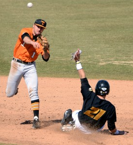 Tennessee second baseman Will Maddox throws to first base to finish the double play as Missouri junior Jake Ivory slides into second base during the sixth inning Saturday, March 15, 2014, during Game 1 of the doubleheader at Taylor Stadium. Ivory batted 2-for-3 with a walk in the doubleheader's first game.