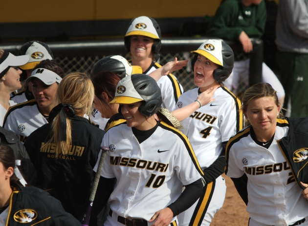 Mackenzie Sykes (4) celebrates her grand slam with teammates Saturday.