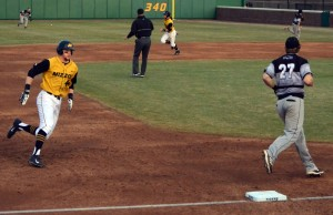 Missouri left fielder Eric Anderson scores on a single by Kendall Keeton in the bottom of the second inning. The Tigers beat the University of Wisconsin-Milwaukee Panthers 7-5 on Tuesday, March 18, 2014 at Taylor Stadium in Columbia, Mo.