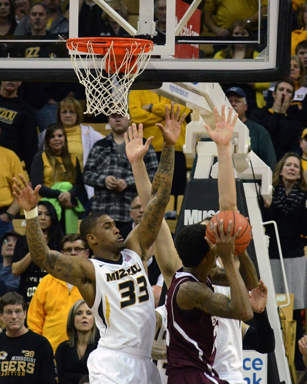 Missouri senior guard Earnest Ross (33) tries to block the shot of a Texas A&M shooter. Ross scored seven points that included a pair of game-winning free throws.