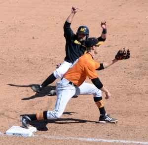 Missouri senior Shane Segovia slides into third base as Tennessee shortstop A.J. Simcox waits for the throw in the fourth inning Saturday, March 15, 2014, during Game 1 of the doubleheader at Taylor Stadium. Segovia was out on the play. Segovia batted 2-for-3 in the game, but Missouri lost 5-1.