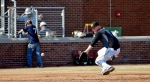 With men working on bleacher railings in the background, Missouri third baseman Zack Lavy fields a ground ball during practice on Thursday March 6, 2014 at Taylor Stadium in Columbia, Mo. (Philip Joens/ KBIA Sports)