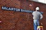 Bill Heitkamp, owner and vice president of Heitkamp Masonry Inc., in Ellisville, Mo., washes dust off the outside of the new McArtor Baseball Facility a day before the Tigers' home opener on Friday March 7, 2014. (Philip Joens/ KBIA Sports).