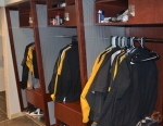 The coaches have a locker room in the new facility, complete with a USB plug and outlets for charging electronic devices.