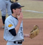 Southern Mississippi relief pitcher Jake Winston licks his fingers between pitches during the seventh inning Saturday, March 8, 2014. The umpires allowed pitchers to lick their fingers because of temperatures in the low 40s, when it is illegal to do so in warmer weather. Winston got a no decision but pitched 4 2/3 innings allowing no runs on three hits.