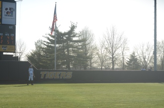 Taylor Gadbois awaits the pitch in her centerfield position at University Field in Columbia, Mo. on Friday, April 18, 2014.
