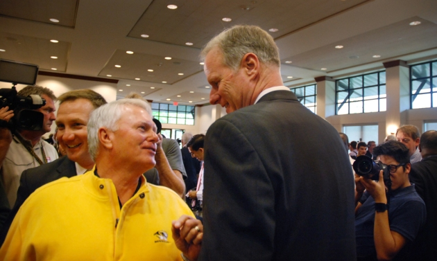 A fan greets Kim Anderson, right, at the event announcing his new job as Missouri's head men's basketball coach. Anderson has deep roots with Missouri basketball, including as a player and an assistant coach.