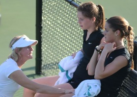 Coach Sasha Schmid talks to doubles partners Alex Clark and Madison Rhyner in between games on Friday, April 11, 2014 at the Mizzou Tennis Complex in Columbia, Mo. Clark and Rhyner would drop their doubles match 8-6.