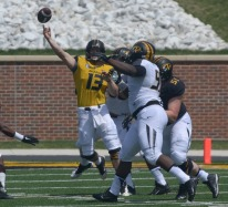 Quarterback Corbin Berkstresser releases a pass before being sacked during the MU spring football game on Saturday, April 19, 2014 at Memorial Stadium in Columbia, Mo. Berkstresser is currently the team's second string quarterback.