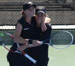 Cassidy Spearman (left) and Kellie Hine (right) celebrate their victory against Sarah McLean and Flavia Araujo of Arkansas. The duo won the set by a final score of 8-6.