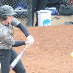 Missouri freshman third baseman Natalie Fleming swings in Game 1 of the Tigers doubleheader sweep of Creighton on Tuesday, April 29, 2014 at University Field in Columbia, Mo. Fleming had two hits in the game.