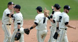 Missouri players celebrate Sunday's win after the final out in the ninth inning. Pictured from left to right are Josh Lester, Kendall Keeton, Shane Segovia (11), Ryan Howard (wearing a tan glove), Jake Ring and Jake Ivory (21). Missouri beat Georgia 4-2 on Sunday, April 6, 2014, at Taylor Stadium.
