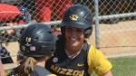 Missouri sophomore outfielder Taylor Gadbois celebrates with freshman third basemen Kelli Schkade after they scored in the Tigers' 9-1 win over Ole Miss on Saturday, April 19, at University Field in Columbia, Mo.  Gadbois finished with two hits in the game.