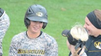 Missouri freshman second baseman Kelli Schkade laughs with freshman pitcher Tori Finucane and junior shortstop Corrin Genovese after hitting a home run in Game 1 on Tuesday, April 29, 2014 at University Field in Columbia, Mo. It was her third home run of the season.