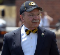 MU Chancellor R. Bowen Loftin stands on the sidelines during the MU spring football game on Saturday, April 19, 2014 at Memorial Stadium in Columbia, Mo. Loftin is in his calendar year as the University of Missouri chancellor.