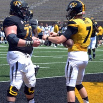 Maty Mauk celebrates a touchdown with teammate offensive lineman Evan Boehm during the MU spring football game on Saturday, April 19, 2014 at Memorial Stadium in Columbia, Mo. Mauk is entering his first year as MU's starter at quarterback.