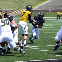 Quarterback Maty Mauk hands off the ball to running back Marcus Murphy during the MU spring football game on Saturday, April 19, 2014 at Memorial Stadium in Columbia, Mo. Murphy replaces Henry Josey as the team's starting running back this coming season.