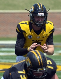Quarterback Maty Mauk prepares for a snap during the MU spring football game on Saturday, April 19, 2014 at Memorial Stadium in Columbia, Mo. Mauk is a redshirt sophomore and is projected to be the team's starting quarterback.