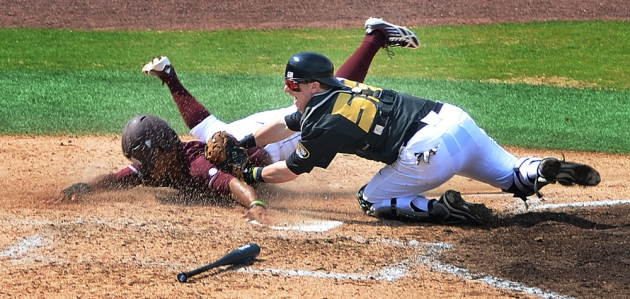 Missouri catcher Dylan Kelly (55) tags out Mississippi State's Derrick Armstrong at home in the top of the fifth inning. Armstrong tried to score after a wild throw to Missouri third baseman Ryan Howard, but Howard recovered the ball in time to throw out Armstrong.