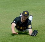 Missouri right fielder Logan Pearson dives to catch a fly ball in the top of the fourth  inning against Mississippi State. The Tigers lost, 6-2.