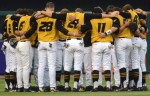 The Missouri Tigers gather for a prayer during pre-game warm-ups before the Arch Rival game.