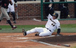 Missouri's DH Erik Anderson scores the first run of the night in the bottom of the first inning for the Tigers in the series opener against the Georgia Bulldogs. Mizzou lost 2-1 to the Bulldogs on Friday, April 4, 2014 and Taylor Stadium in Columbia, Mo.