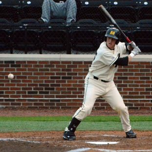 Tiger catcher Dylan Kelly hits a single in the bottom of the second, the first hit of the game for Missouri. The Tigers bats would heat up as Missouri went on to beat the Redhawks 6-5 on Tuesday, April 29, 2014 at Taylor Stadium in Columbia, Mo.
