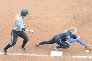 Missouri junior infielder Angela Randazzo reaches first base on an error in Game 1 against the Blue Jays on Tuesday, April 29, 2014 at University Field in Columbia, Mo. Randazoo pushed her season RBI total to 36, which ranks third on the Tigers.
