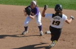 Missouri centerfielder Kelli Schkade tries to beat out a throw to second base during the Tigers' 4-2 win in Game 1 over Western Illinois. Schkade had three RBIs in the doubleheader.