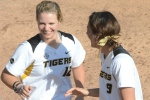 Missouri's Angela Randazzo (12) and Taylor Gadbois celebrate their Game 1 victory over the Western Illinois Leathernecks. Randazzo sparked Missouri's offense in Game 2 with an RBI-single in the first inning.