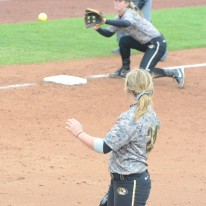 Missouri freshman pitcher Casey Stangel watches freshman third baseman Natalie Fleming field a ball in the Tigers' two-game sweep of Creighton on April 29, 2014 at University Field in Columbia, Mo. Stangel pitched five scoreless innings in Game 1.