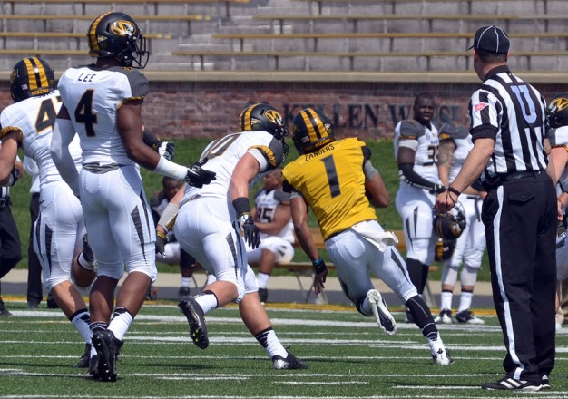 Freshman quarterback beats defenders on an 80-yard touchdown run with less than one minute left to help the reserves beat the starters 21-20 during the MU spring football game on Saturday, April 19, 2014 at Memorial Stadium in Columbia, Mo. The reserve were granted a 14-0 lead to start the game.