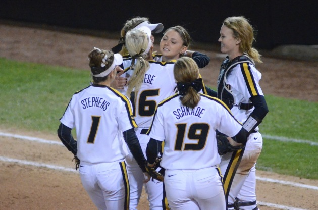 Missouri pitcher Tori Finucane hugs Corrin Genovese after recording the final out on Thursday, May 1, 2014 at University Field in Columbia, Mo.  The Tigers will play Bradley University in the second game of the NCAA softball regional held at University Field on Friday at 4:00 p.m.