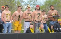 University of Missouri students brave the cold to spell out MIZZOU in body paint over the left field wall on Thursday, May 1, 2014 at University Field in Columbia, Mo. The temperature at the start of the game was 52 degrees.