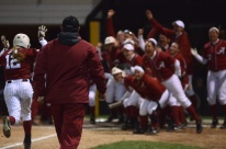 Alabama coach Patrick Murphy watches left fielder Kallie Case run towards her teammates at home plate after she hit a grand slam in the fifth inning on Thursday, May 1, 2014 at University Field in Columbia, Mo. Her grand slam gave Alabama the lead 6-5.