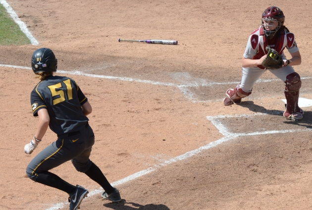 Missouri catcher Sami Fagan retreats to third base after getting caught trying to advance home in the sixth inning on May 3, 2014 at University Field in Columbia, Mo.  Fagan was tagged by Alabama shortstop Danae Hays.