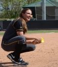 Senior Mackenzie Sykes laughs as she fills up a bottle with dirt from the mound on senior day on May 3, 2014 at University Field in Columbia, Mo. Sykes played for four years at Missouri, and was named a First Team All-Big 12 selection as a sophomore.