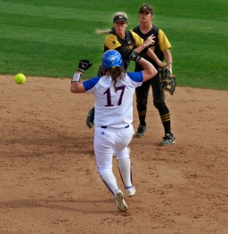 Kelli Schkade, right, and Corrin Genovese watch as Genovese' s throw heads to first after putting out Taylor Dodson (17). The double play got Missouri out of a bases-loaded situation in the sixth inning.