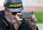"Facilities manager Allen ""Frosty"" Frost takes pictures during the topping off ceremony at Memorial Stadium."