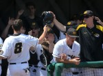 Missouri freshman Ryan Howard (8) receives congratulations in the dugout after scoring a run in the fourth inning. Howard scored on a bases-loaded walk by Dillon Everett.
