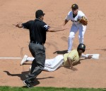 Missouri third baseman Ryan Howard and Vanderbilt's Xavier Turner look to third base umpire Darren Spagnardi as he rules Turner safe at third base in the eighth inning. Turner advanced on a ground ball by Bryan Reynolds.