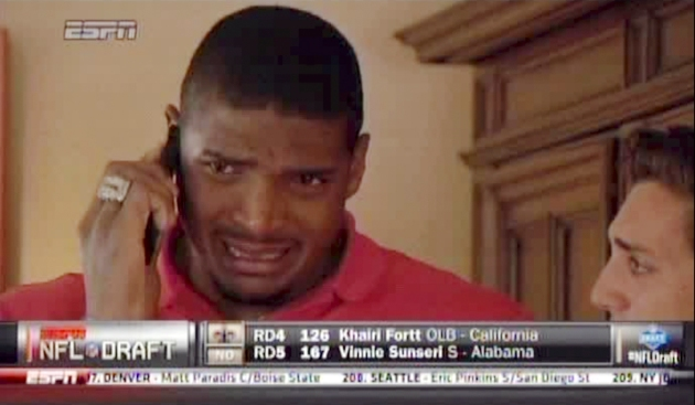 In a photo taken from ESPN television, Michael Sam cries while talking on the phone after being selected by the St. Louis Rams in the NFL Draft. Sam, who came out as gay in February, was selected on Saturday, May 10, 2014, in the seventh round of the draft.
