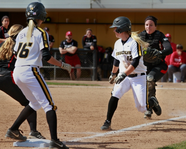 Angela Randazzo (12) gets caught in a run-down as Corrin Genovese (16) watches from third base. Randazzo was put out on the play by catcher Bailiegh Basham, but Mackenzie Sykes was able to reach second.