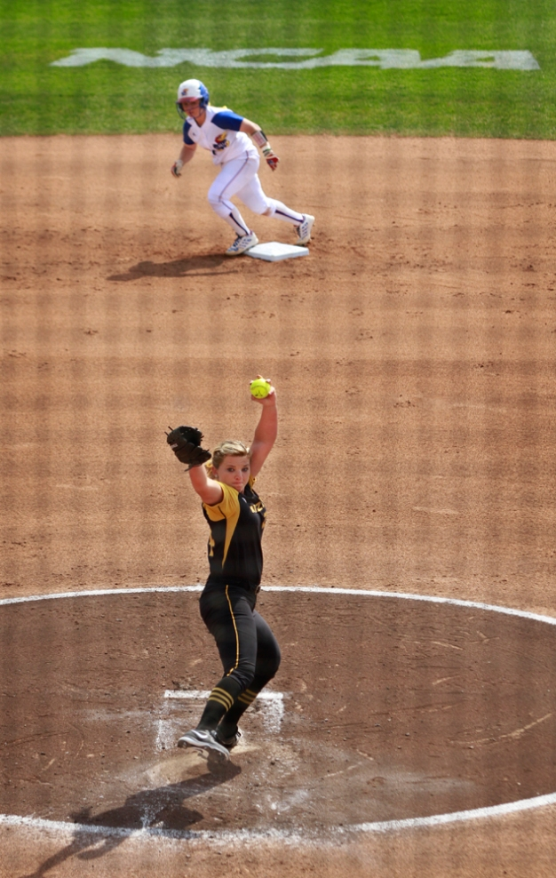 Casey Stangel pitches with a runner at second in the first inning.