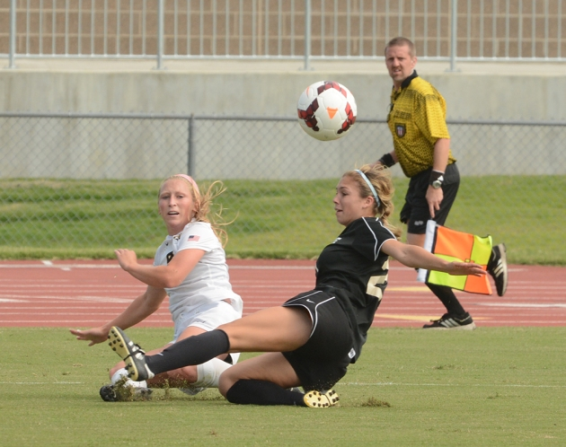 Missouri's Kaysie Clark (9) gets a shot on goal as she avoids Cal State Northridge defender Kendall Moskal (12) on Sunday, Sept. 14, 2014, at Walton Stadium in Columbia, Missouri. Clark now has a team-high eighth assists on the year.