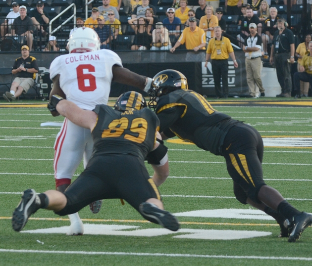 Missouri defensive lineman Matt Hoch (89) and Missouri linebacker Kentrell Brothers (10) are unable to bring down Indiana running back Tevin Coleman (6) on a screen pass on Saturday, Sept. 20, 2014 at Faurot Field in Columbia, Missouri. Coleman had 19 carries for 132 yards rushing in Indiana's 31-27 win.