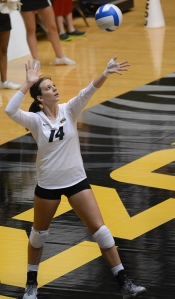 Outside hitter Sydney Deeken winds up as she serves. Deeken got her second career start today, and had seven kills on a .143 hitting percentage, as well racking up three block assists.