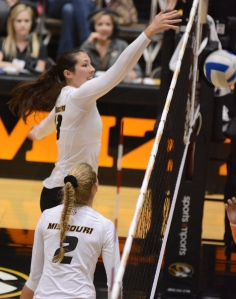 Outside hitter Emily Wilson kills a ball with a block.